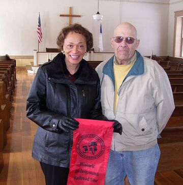 Cathy Nelson, Founder of the Friends of Freedom Society,and John Ittel in Hopewell Church