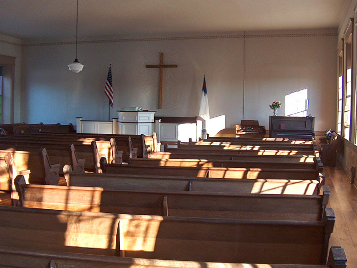 Wooden pews in the empty church